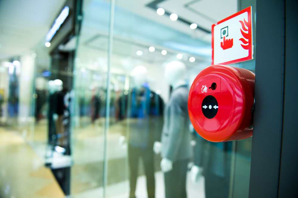 Fire alarm mounted on the wall in a shopping center