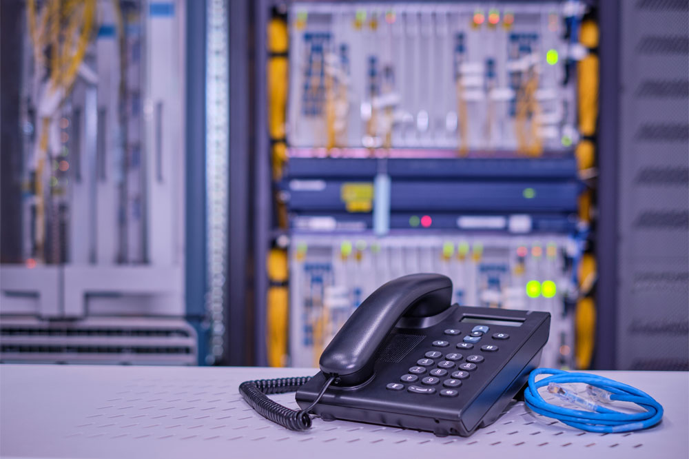 Phone sitting on a table in a server or phone line room